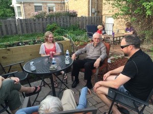 Our graduate, her grandpa, and Neighbor Guy #1 enjoy the patio at her graduation party.
